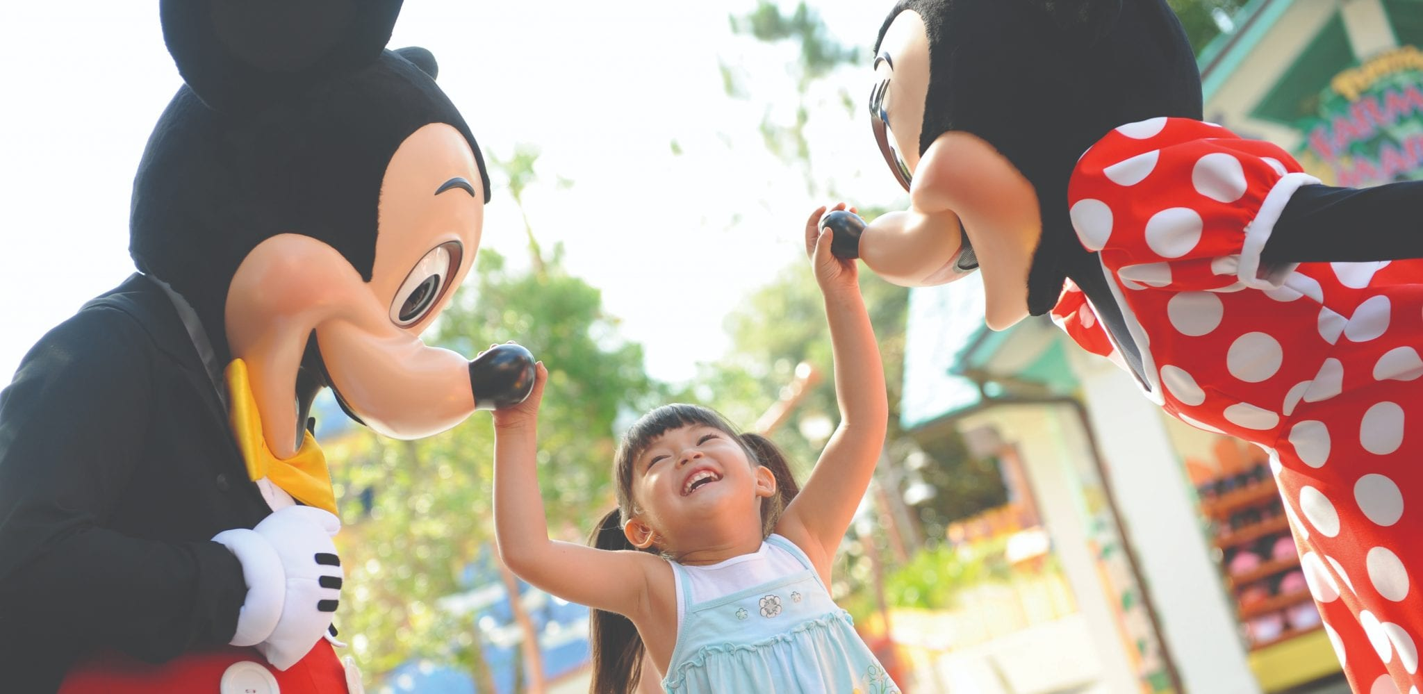 Child with Mickey and Minnie Mouse